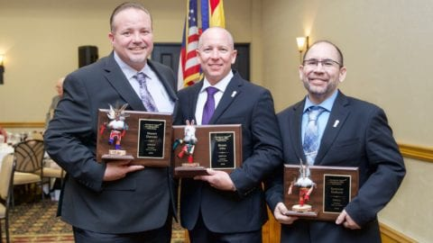 Southwest Cable Communications Association Hall of Fame inductees stand together as they hold their awards.