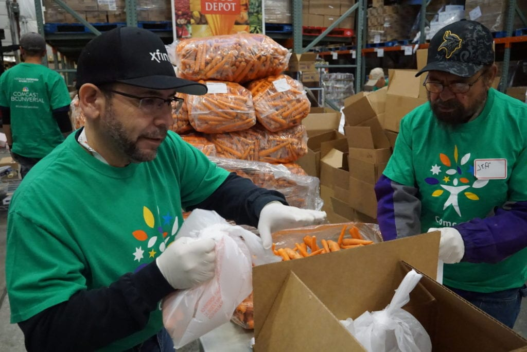 Spencer volunteering at the Santa Fe Food Depot on Comcast Cares Day in 2018